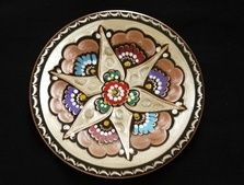 The art of Minakari or Enamelling is called miniature of fire as well as the decoration of metal and tile with mina glaze. Minakari or Enamelling is the art of painting, colouring and ornamenting the surface of metals by fusing over it brilliant colours that are decorated in an intricate design.