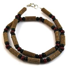 Hazelwood Burgundy & Black Necklace! Effective in reducing acid-based ailments and symptoms, such as eczema, acid-reflux, and heartburn, and ulcers. Must be placed directly on the skin and worn 24/7. Made with nylon-coated steel wire, hazelwood and assorted beads, and nickel clasp (lobster style opening).