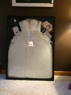Wedding dress in a shadow box get the largest one from hobby lobby! I need to do this for my dress!!!!!