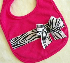 Even the littlest divas deserve some glam! This bright pink cotton/poly blend bib has a black & white zebra print ribbon stitched on, and a cute matching bow to top it off. Perfect for any sweet baby girl! Baby Sewing Projects, Sewing For Kids, Baby Kind, Baby Love, Baby Zebra, Pink Zebra, White Zebra, Black White, Burp Rags