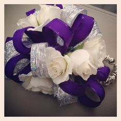 Floral purple corsage. Great for proms and weddings!