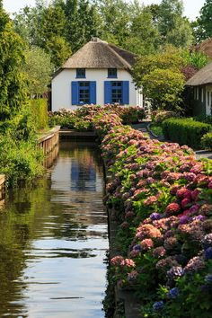 """Tucked away in the rural Netherlands is Giethoorn, a picturesque village that's earned the nickname """"Dutch Venice"""" because it lacks roads or any form of modern transportation. To get around, you travel the old-fashioned way—via canals or on foot across one of its 176 bridges. The peaceful setting, founded around 1230, features a series of small waterways that guide boats past its historic architecture and luscious vegetation. Similar to vehicle-occupied roads, the canals have their own…"""