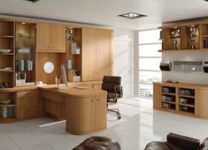 Optima Oak - warm oak tones, generously curved profiles, the Optima home study furniture creates a stunning work area