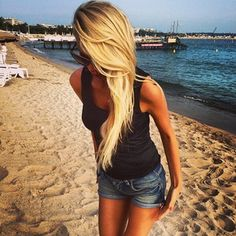 i want her hair coloe so bad it is almost a bleach blonde but a little darker and sunny