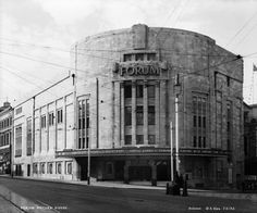 Art Deco cinema building with large curved facade on street corner. Lime Street, Liverpool