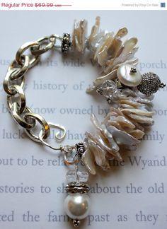 Sale SHOP SALE halo chunky chain cuff heshi pearl vintage charm bracelet. $59.49, via Etsy.