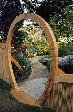 20 Beautiful Garden Gate Ideas. Path on the other side of gate. Whimsical. Winding. Flowers. Almost like looking at a framed picture.