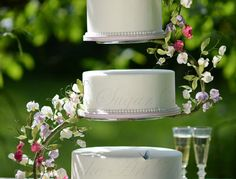 Wedding cake with flowerpaste sweet peas wired to a s-shaped cake stand
