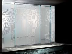 he spiral etched glass barn sliding door system is part of our frameless glass series of doors which feature both swing doors, sliding doors, barn sliding doors and fixed panel systems.