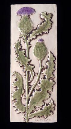 Decorative handmade ceramic tile: Handmade relief carved ceramic thistle tile