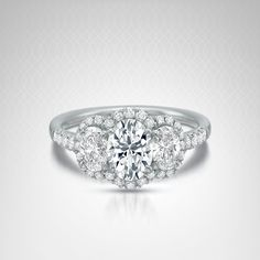 Certified Norman Silverman Oval Three-Stone Diamond Engagement Ring in Platinum (2 1/6 carat t.w.)