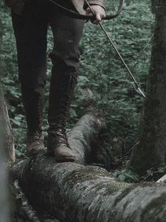 Hunger Games Aesthetic Walking on log Katniss Everdeen