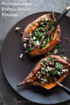 baked sweet potatoes are stuffed with feta, olives and sun-dried tomatoes