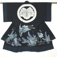 Tsutsugaki is a method of free-hand resist dyeing practised for many centuries in Japan.  A paste is applied to the cotton fabric with a 'tsutsu' before the fabric is repeatedly dipped in indigo to achieve a rich depth of colour.  In some cases, additional colours are painted onto the resist areas.