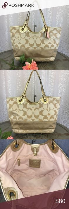 """Coach Signature Stripe Carryall Bag F19565 Khaki Signature khaki fabric and metallic gold leather trim. One large compartment with dog clip closure. Inside light pink lining is clean with very minimal wear. One zip pocket and 2 multifunctional pockets inside. Exterior signature fabric is in excellent condition, with a few small frayed areas. Light wear to bottom corners. The dual leather straps are discolored from use. Includes 2 Coach leather hangtags. Measures 17.5""""L x 9""""H x 5.5""""D 10""""…"""