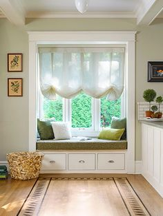 A stained-on board rug guides the eye toward this cozy window seat.