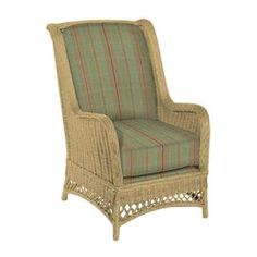 Wicker arm chair with plaid upholstery.    Product: Arm chair   Construction Material: Solid kiln dried poplar wood, wicker and polyester fabric   Color: Natural and sea foam   Features:   Plaid pattern  Casual country style  Turned legs 12 Row and 8 gauge sinuous wire springs  High resiliency 2.0 foam core with blend down wrap  Made in the USA      Dimensions: 43 H x 27 W x 34 D