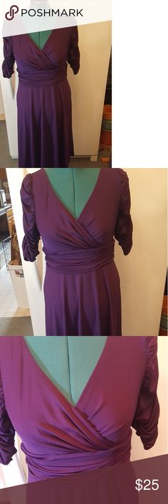 Every pretty deep purple ruched sleeve dress Size 12 stretchy ever pretty dress featuring a ruched waist and sleeves. Very comfortable and in excellent condition. about tea length. color is a royal purple, not a plum red purple, that was a lighting issue. Ever pretty Dresses Midi