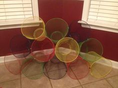 For organizing toys. Dollar Store Trash baskets tied with zips or whatever the name is.