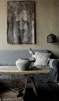 Grey couch. Khaki wall.
