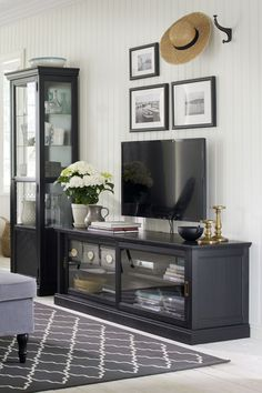 The IKEA MALSJÖ TV unit with sliding doors is not only a functional way to store your remotes, cables and TV accessories, but also is a beautiful piece of handcrafted furniture - perfect for any traditional living room space!