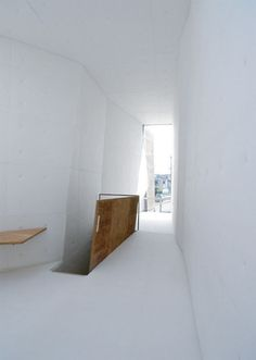 This house in Osaka by architects Suga Atelier has a faceted concrete exterior that looks like a rockface.