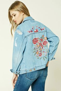 A denim jacket featuring floral embroidery on the back, a distressed design, button front, a basic collar, two front flap button pockets, front slit pockets, and long button cuff sleeves.