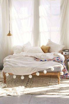 No Headboard Ideas bedroom with tassel blanket