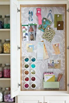Here's a super handy organization tip: use a magnetic office organizer to help hold swatches, notes, and small notions in your sewing space.