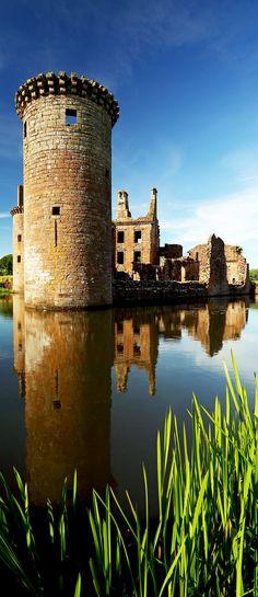 Caerlaverock Castle reflecting on the moat that surrounds the castle. Dumfrieshire, Scotland.