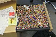Office prank! - drawer with crap filled in it.   Idea: buttons, beads, cereal, etc.   @performPlus