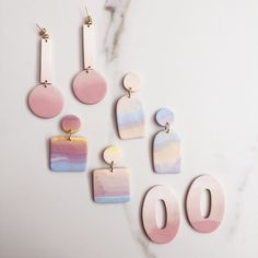 Polymer clay earrings in dusty mauve and sunset. - Polymer clay earrings in dusty mauve and sunset. Polymer Clay Charms, Polymer Clay Jewelry, Resin Jewelry, Polymer Clay Miniatures, Polymer Clay Projects, Jewellery, Diy Clay Earrings, Earrings Handmade, Bijoux Diy