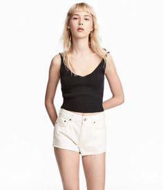 Black. Short top in a soft knit with narrow shoulder straps, V-neck, and ribbed hem.