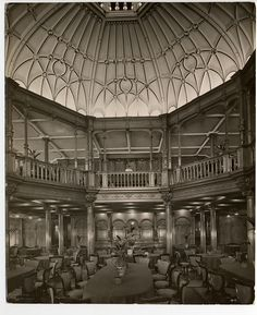 Mauretania's interiors. The first-class dining saloon was inspired by mid-16th century French châteaux. Above its oak splendor rose a dome dotted with the signs of the zodiac. The same space in third class was simple and utilitarian. Both spaces had communal tables and swivel chairs, holdovers from the 1800s.
