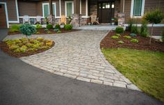Old Wold cobblestone walkways to entrance on home. Landscaping & hardscape done by McKay Nursery Company in Wisconsin.