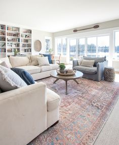 gorgeous lake house family room white sectional gray/blue accent chair with vintage style rug Lake House Family Room, House Rooms, Cozy Family Rooms, White Sectional, Living Room Sectional, Family Room With Sectional, Rugs In Living Room, Living Room Designs, Living Room Decor