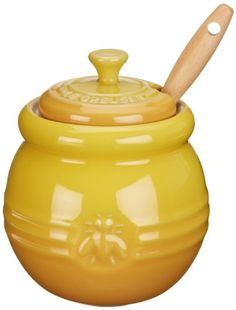 Le Creuset honey pot includes a silicone dipper that dispenses the perfect touch of honey