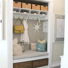 Entryway closet makeover - I did something similar to this in my last house and LOVED it.  Take off the closet doors and treat it like a little alcove...