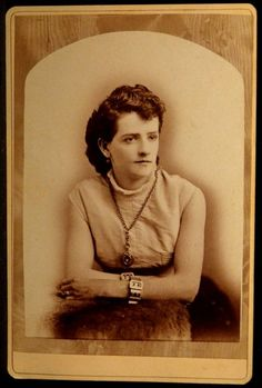 An unusually dressed (for this era) woman, bare arms and big clunky jewelry.  Cabinet photo by Flagor, Eureka, CA.
