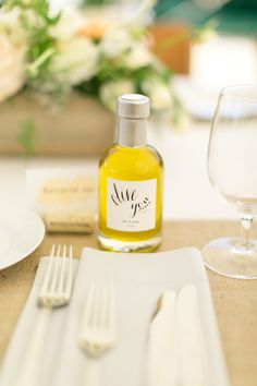 """Olive you"" stickers, little bottles of olive oil, wedding favor ideas // Hannah Suh Photography"