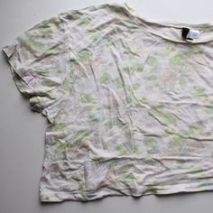 NEW Crop Tee with Pastel Floral Pattern New, never worn cropped tee with a very cute pastel floral pattern. Soft Jersey material. Flowy loose fit but cropped length - fits really well! Scoop neck.  ***Looking to sell ASAP so make an offer!*** H&M Tops Crop Tops