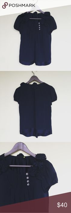 Leifsdottir Silk Blouse blue navy Gorgeous short sleeve blouse by Leifsdottir. 100% silk. Super cute flower detailing. Elastic sleeve cuffs. Size 2. In excellent pre-worn condition. No trades. Anthropologie Tops Blouses