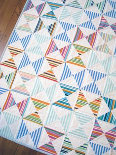 "I like the striped hourglasses here in this ""Stripey Quilt 1"" by Jacqueline of BIND, guest posting at Sew Mama Sew."