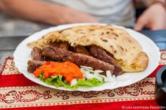 From the Archives: Postcard: Eating Ćevapi in Bosnia #NaPhoPoMo - http://www.lolaakinmade.com/photo/postcard-eating-cevapi-bosnia-naphopomo/… #Travel #ttot
