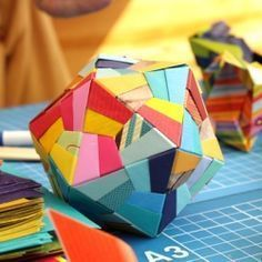 complicated but very cool Icosahedron origami ball. Use washi tape to add even more detail if you want. Here's a good video tutorial: http://www.youtube.com/watch?v=H7qE_Tc8e4g=related