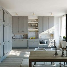 Grey shaker kitchen with ceiling-height cupboards
