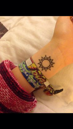 Favorite sun tattoo (with ohm in it)