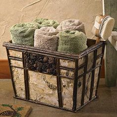 The Birch Bark & Pinecone Basket is a unique basket with many uses. The natural blend of Birch bark, twigs, and pinecones create a rustic, yet beautiful basket that can be used for anything from towels in the bathroom to magazines next to the couch.