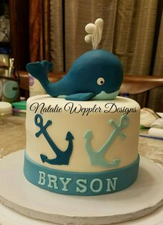 This baby shower cake features a nautical theme with a baby whale and anchors.  It is a six inch cake that will feed ten people.