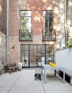Steel windows NYC townhouse garden courtyard patio ; Gardenista. During a recent remodel, a 16-foot-wide townhouse in New York City got a wall of factory windows made of hot rolled steel.